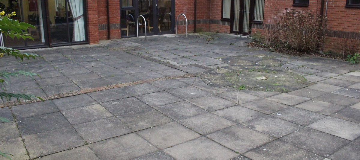 Before work started on The Courtyard Garden at Keech Hospice Care the space was grey and uninspiring.